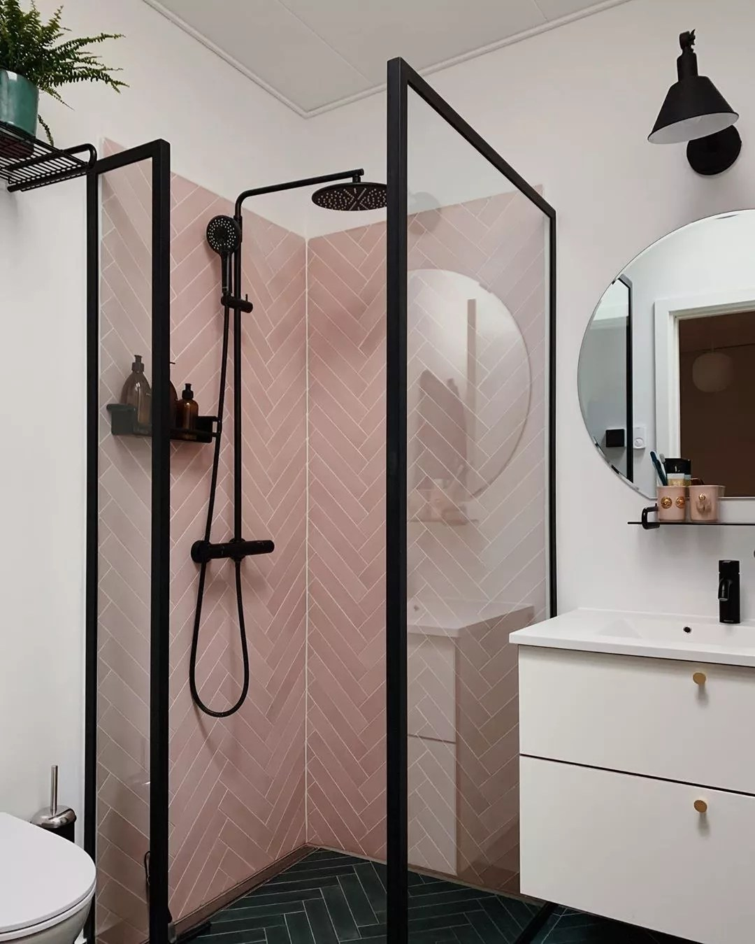 Modern bathroom with pink tile in shower. Photo by Instagram user @ditteblog