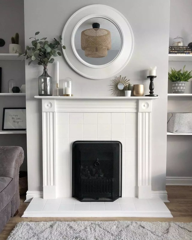 Living room fireplace with white tile. Photo by Instagram user @aboutmyhouse_