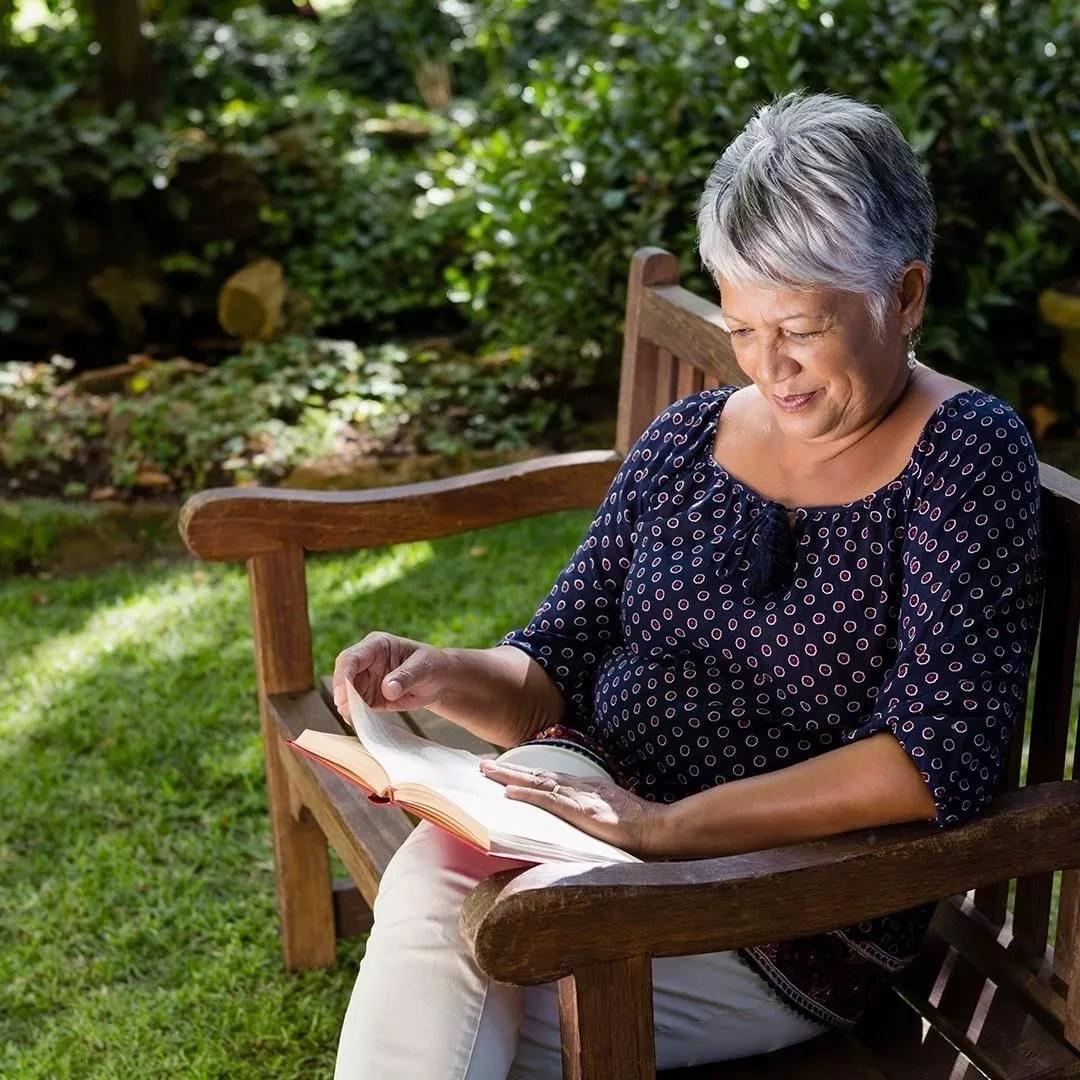 Elderly Woman Reading a Book. Photo by Instagram user @fallbrookglenofwesthills