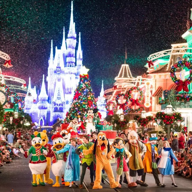 Disney characters walking in Christmas parade at Disney World. Photo by Instagram user @thehappiestinstaonearth