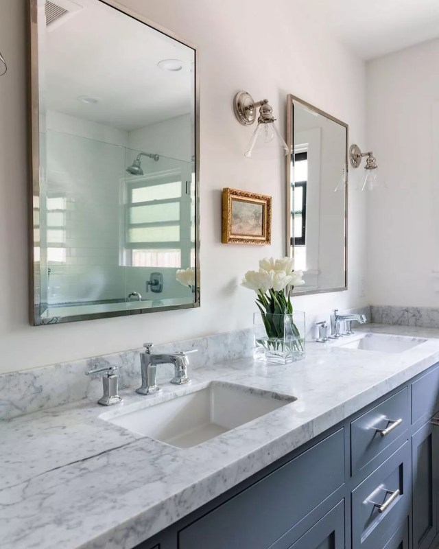 His and hers sinks in bathroom with small decorative accents. Photo by Instagram user @blairdesignandinteriors
