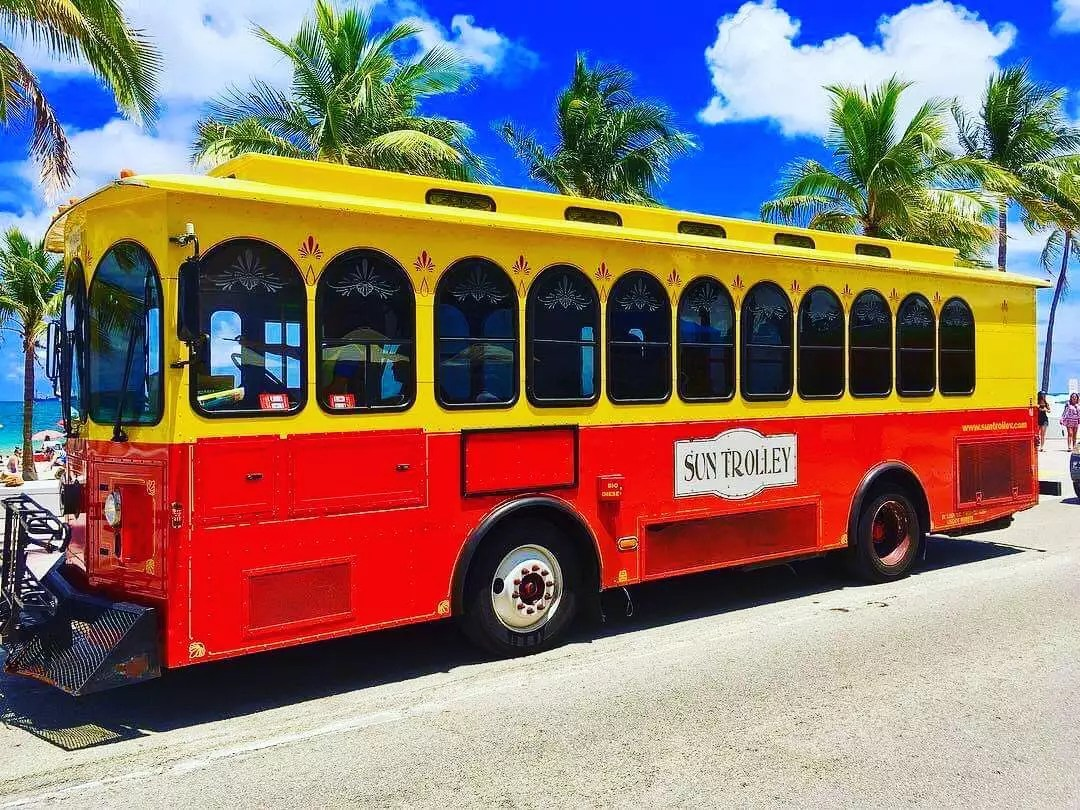 Red and Yellow Public Trolley on Fort Lauderdale Beach. Photo by Instagram user @adventures.of.jason.fll