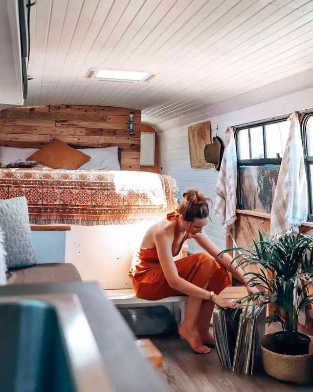 Woman Looking at Different Carpet Samples While Sitting in Her Tiny Home. Photo by Instagram user @gooseandellen