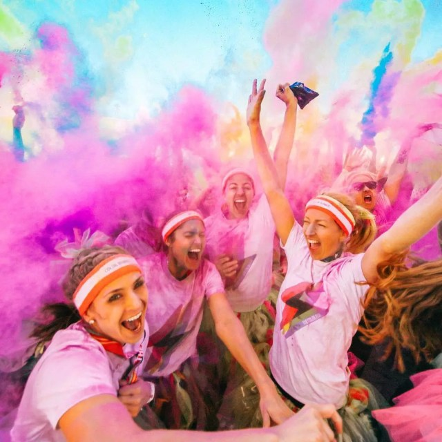 Women Excitedly Screaming Amid a Cloud of Paint During the Color Run. Photo by Instagram user @thecolorrun