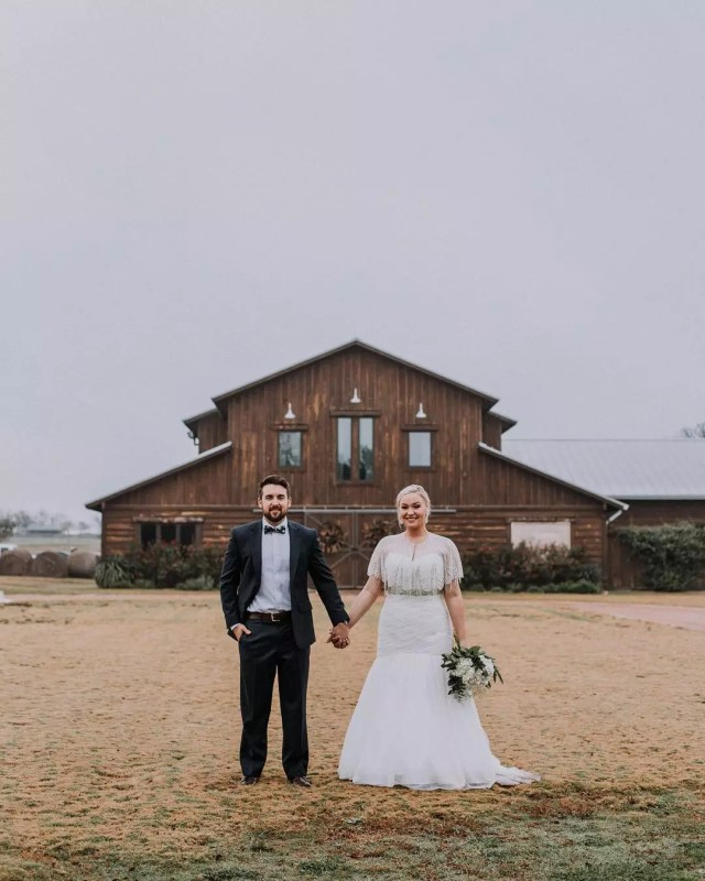 Bride and Groom Holding Hands in Front of a Barn in Austin. Photo by Instagram user @loneoakbarn
