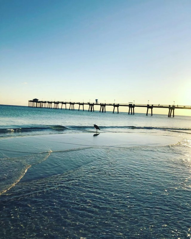 view of the ocean and fort walton beach pier photo by Instagram user @emeraldcoasthappenings