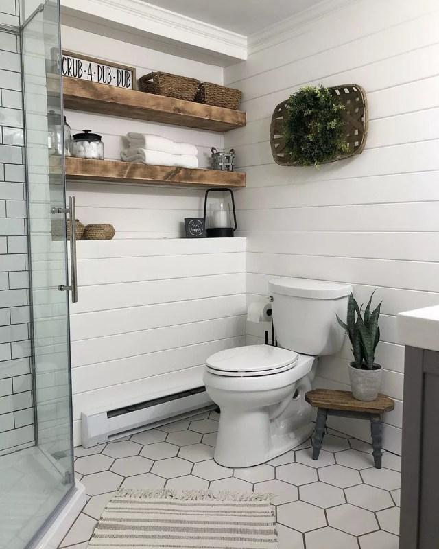 Bathroom with Towels, Baskets, and Jars on Wall Storage. Photo by Instagram user @vintagewhiteoak