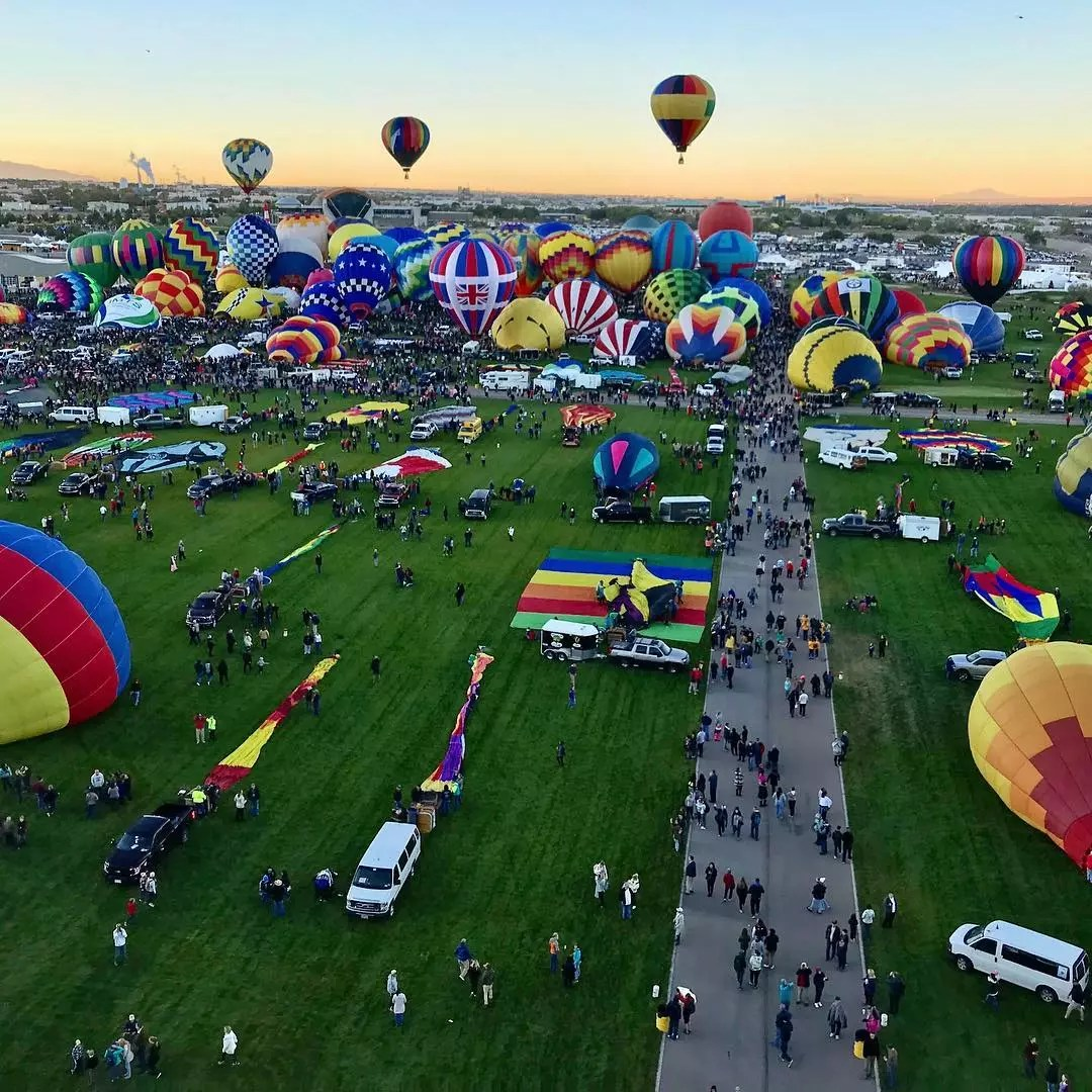 Overhead view of hot air balloons being unloaded at the Albuquerque International Balloon Fiesta. Photo by Instagram user @outofoffice247