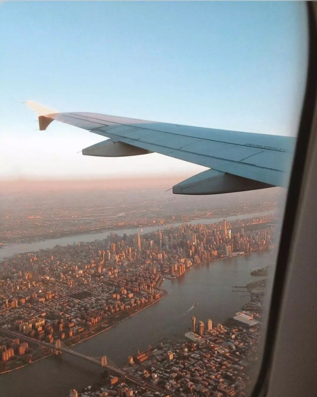 View of Newark and a plane's wing from inside a plane. Photo by Instagram user @madametamtaaam