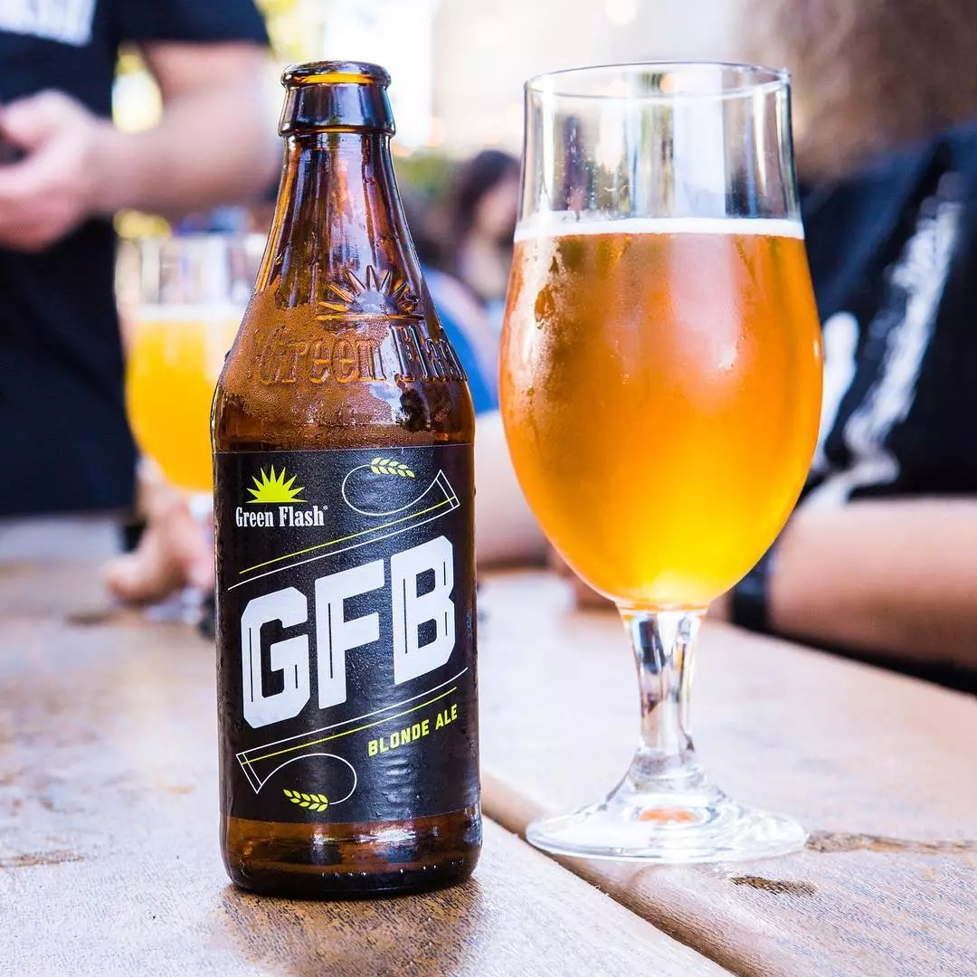Glass of beer and empty beer bottle. Photo by Instagram user @greenflashbeer