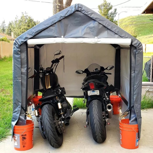 two motorcycles being stored inside of an at home shelter photo by Instagram user @meli_matic