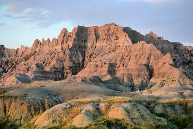 Red canyons in the Badlands during sunset. Photo by Instagram user @badlandsnps