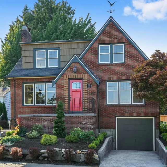 Two-story brick home with a red front door in Laurelhurst, Seattle. Photo by Instagram user @krissy_ayad