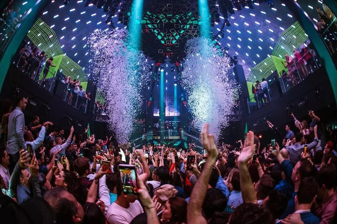 People dancing in a nightclub with confetti at LIV in Miami, FL. Photo by Instagram user @livmiami