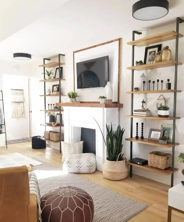 Living room painted white with brown decor for a Feng Shui design. Photo t\by Instagram user @kaza.karis