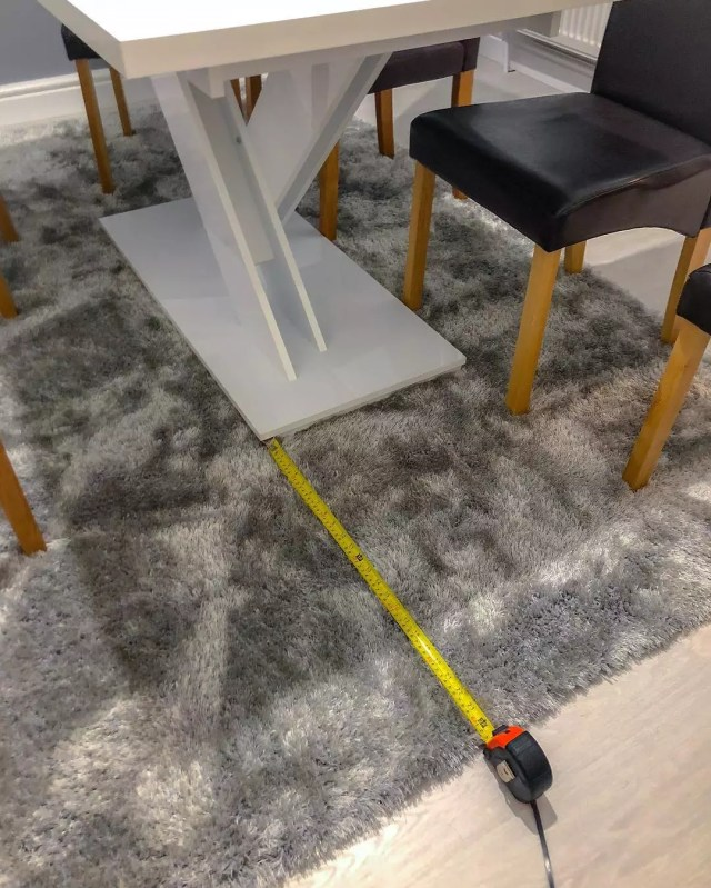 Measuring the distance between a table and carpet.