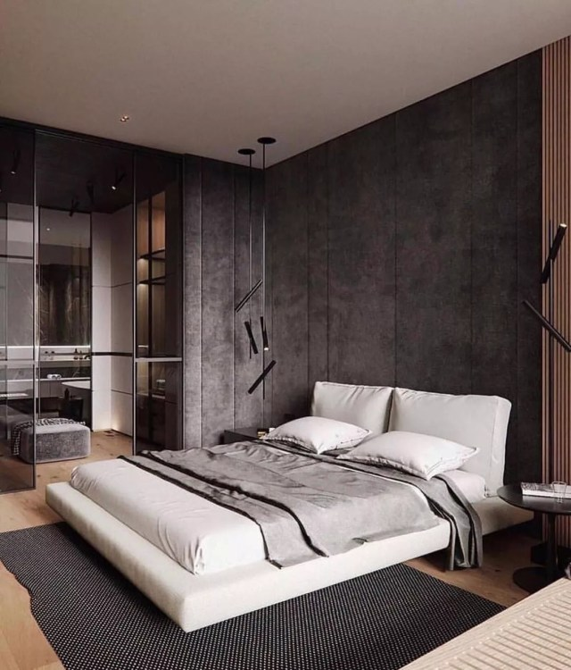 Bedroom designed in Modern style with gray walls and a bed with white sheets on a platform frame. Photo by Instagram user @architect_mustafayev