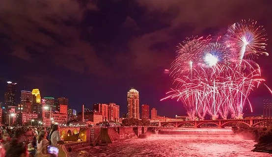 Red fireworks going off above Minneapolis for the Water Festival. Photo by Instagram user @aquatennial