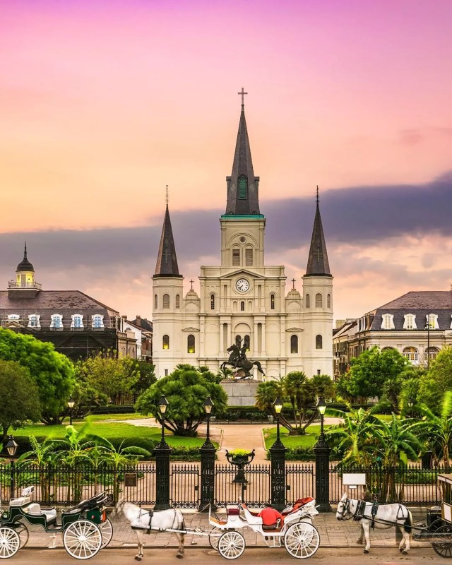 White St. Louis Cathedral with a purple sunset in New Orleans. Photo by Instagram user @tripadvisor