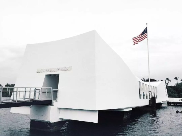 All white USS Arizona Memorial building hovering on water. Photo by Instagram user @dcarlo7
