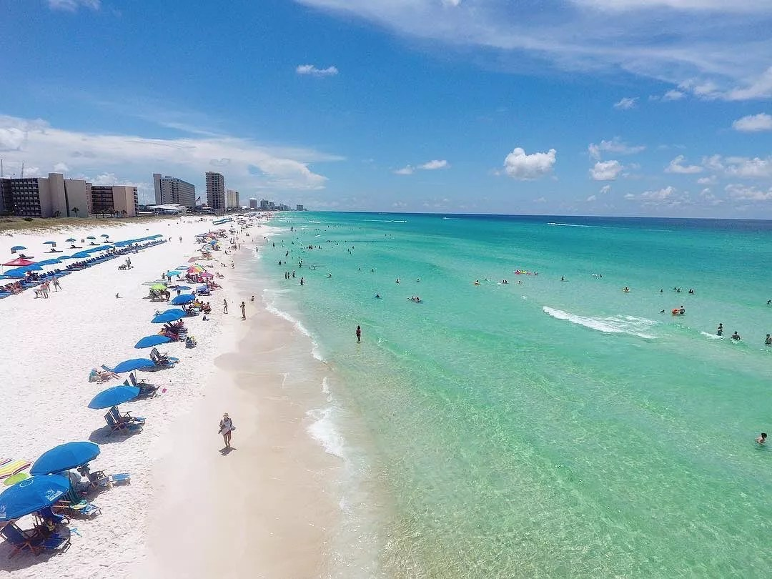 Skyline of the beach and clear waters in Panama City Beach. Photo by Instagram user @adventuresatseapcb