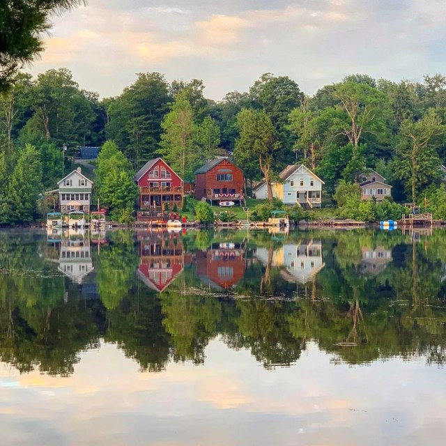 Row of lake houses on Caroga Lake, NY. Photo by Instagram user @speakinglens