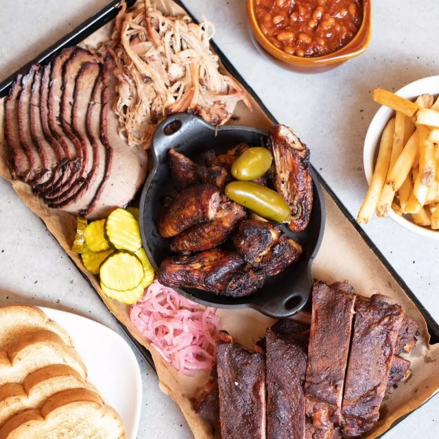 Tray full of barbecue and fries. Photo by Instagram user @jackstackbbq