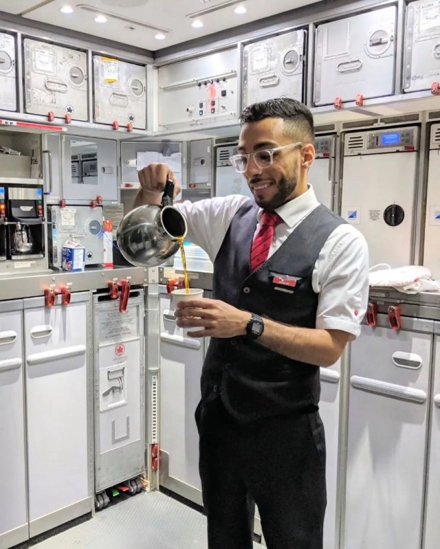 Male flight attendant with Air Canada pouring coffee. Photo by Instagram user @globetrotter95_