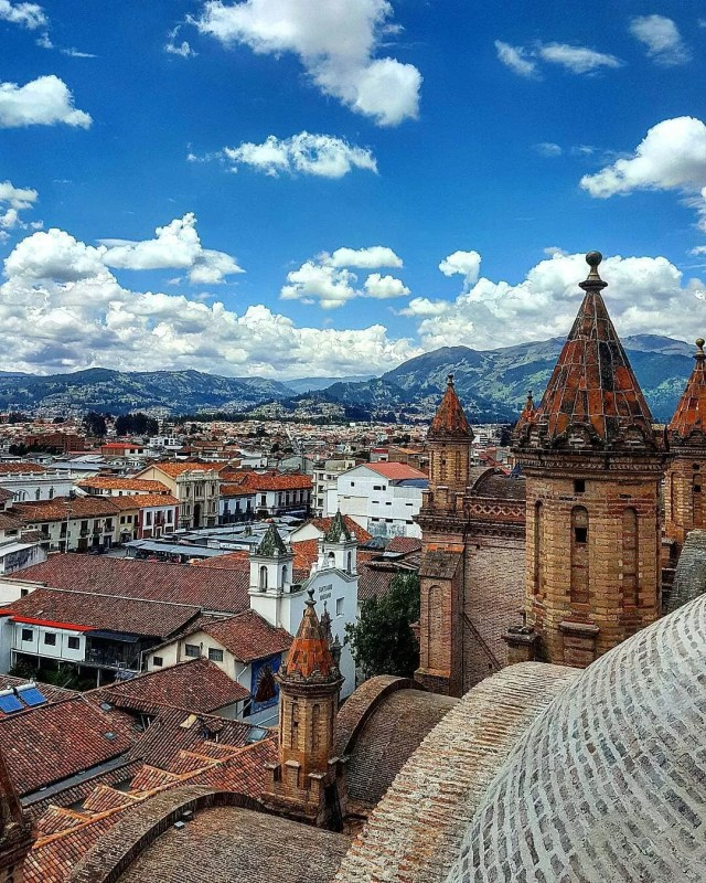 Skyline of churches and homes in Cuenca, Ecuador. Photo by Instagram user @pedroflores2286