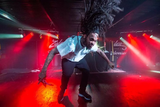 African man jumping around on stage. Photo by Instagram user @joshweichman