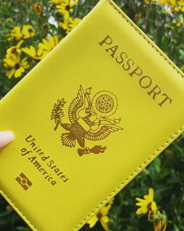 Girl holding a yellow passport. Photo by Instagram user @prettylittlepassports