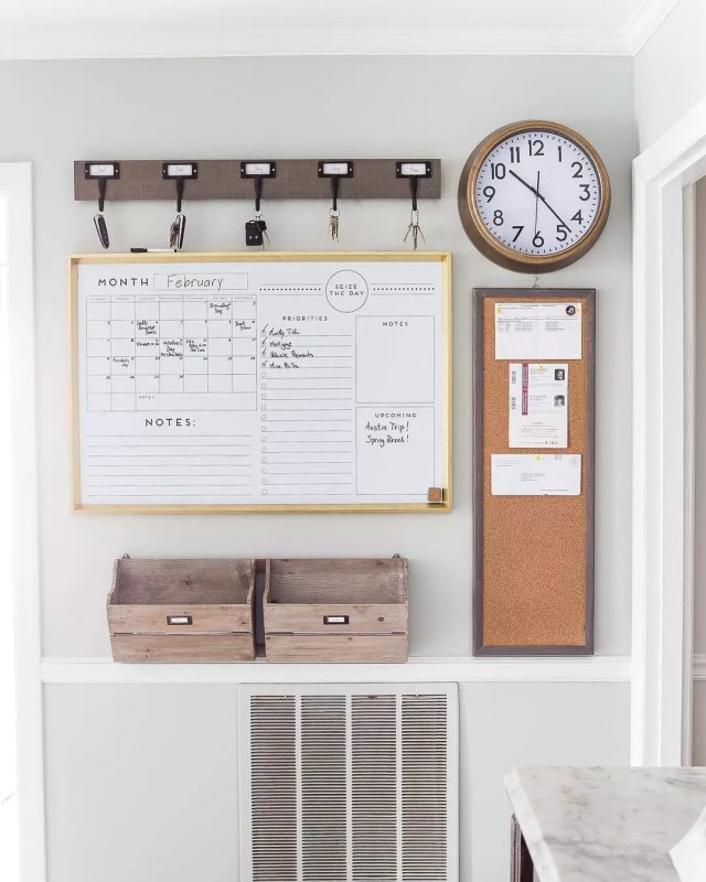 Calendar and clock and hooks on a wall. Photo by Instagram user @organizerjanet