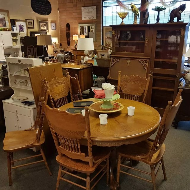 Antique brown table and chairs. Photo by Instagram user @goods_at_the_hoods