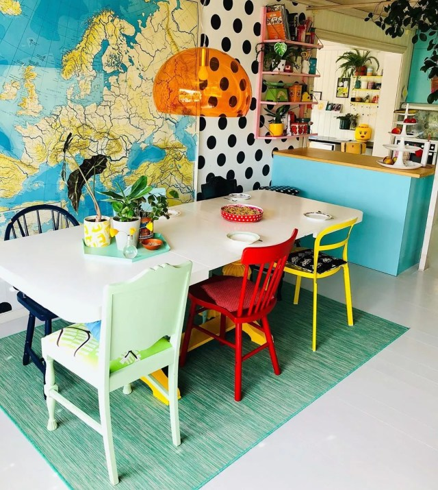 Kitchen with multicolored chairs and polkadot walls. Photo by Instagram user @polkadotgrid
