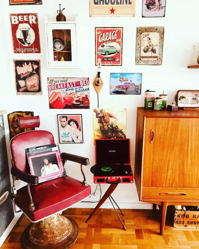 Room with tin signs on wall and red chair. Photo by Instagram user @vampeva