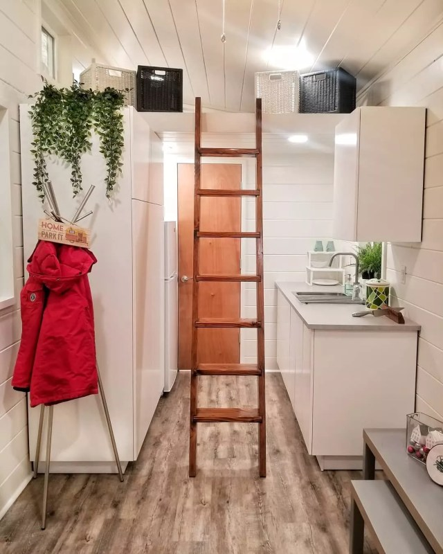 Tiny home with white walls and white cabinets. Photo by Instagram user @backcountrytinyhomes