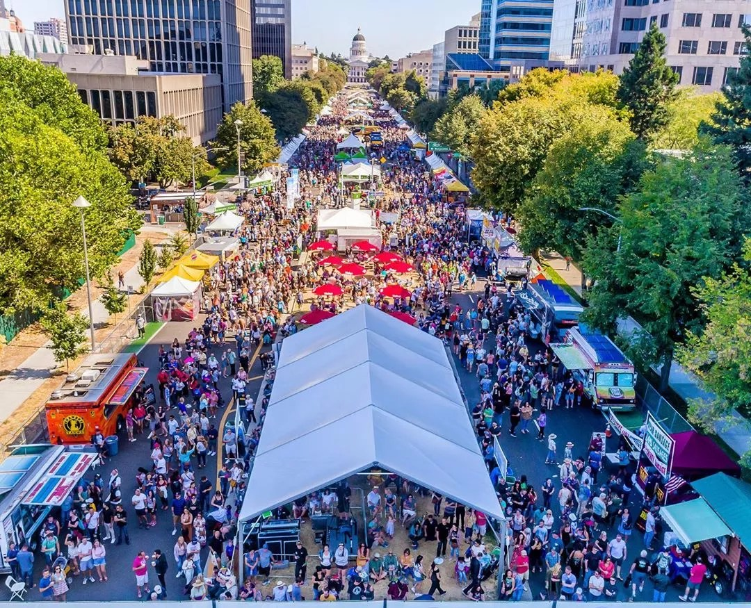 Aerial view of people at festival. Photo by Instagram user @aerialsacramento