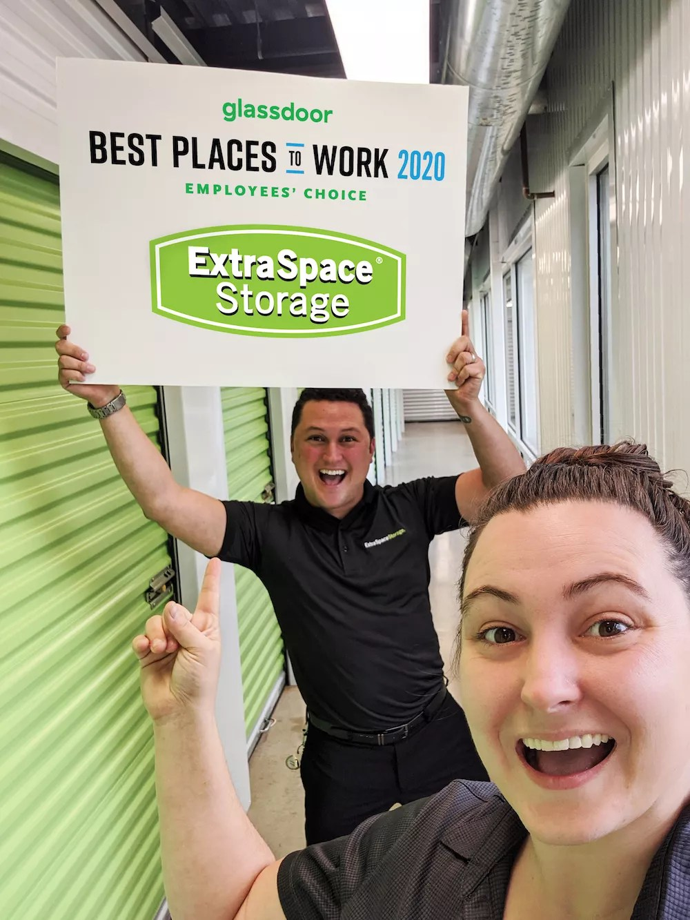 Extra Space Storage team members holding sign that says Glassdoor Best Places to Work 2020