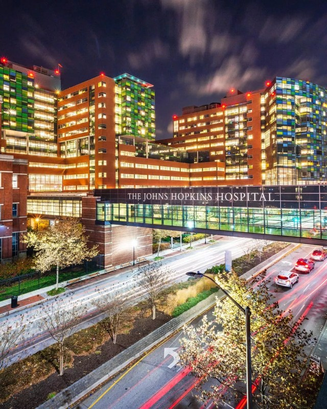 Johns Hopkins Hospital lit up at night time. Photo by Instagram user @hocofoto