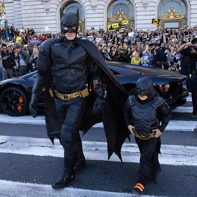 Man and little boy dressed as batman. Photo by Instagram user @batkidbegins