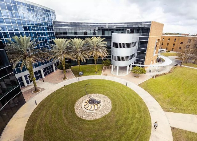 Aerial view of glass building and campus at University of Central Florida. Photo by Instagram user @ucf.edu