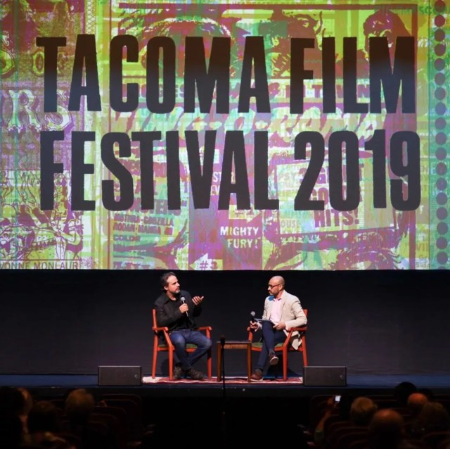 Two guys sitting on stage at Tacoma Film Festival. Photo by Instagram user @tacomafilmfest