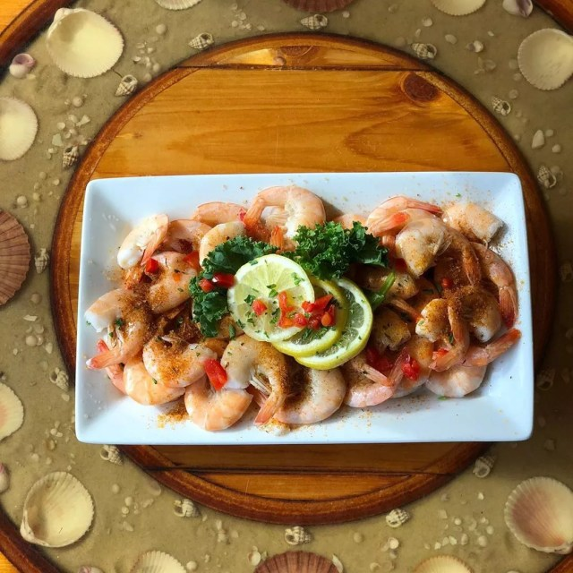 Plate of shrimp on a table. Photo by Instagram user @captaingeorges