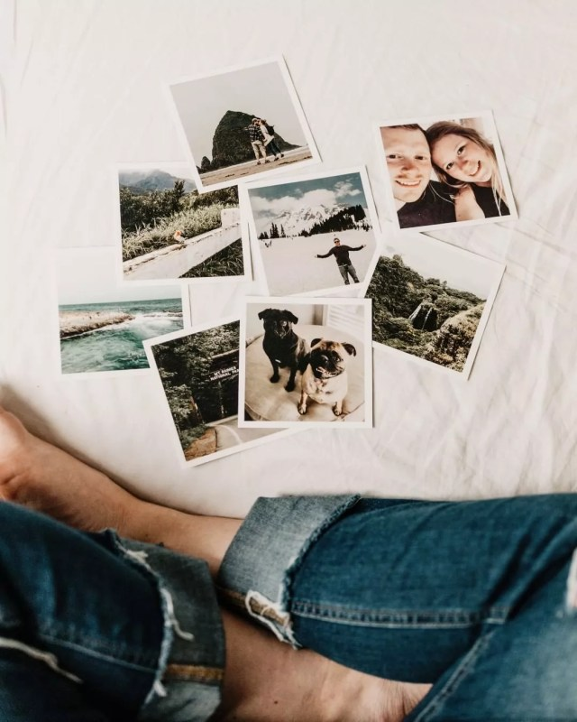Pictures scattered on a bed. Photo by Instagram user @surround_us