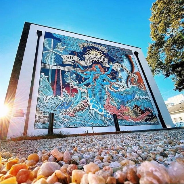 Wall mural of blue mermaid in the Vibe Creative District. Photo by Instagram user @thevibecreativedistrict