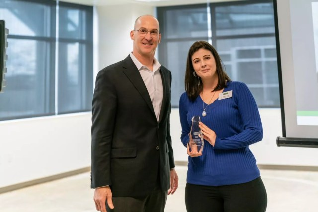 Bethany Kuenstler, District Team Lead, poses with Joe Margolis, CEO of Extra Space Storage