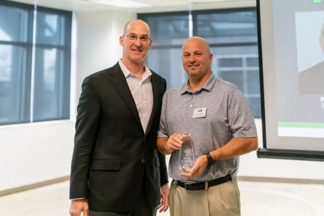 Robert Raymond, District Manager, poses with Joe Margolis, CEO of Extra Space Storage