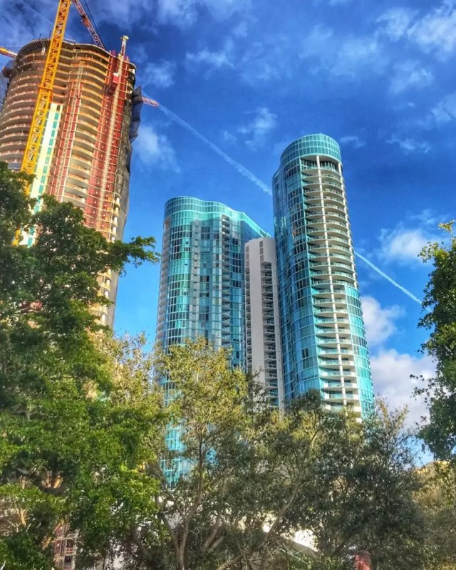 Red and blue high rise buildings in Tarpon River, Fort Lauderdale, FL. Photo by Instagram user @lisamascolo37