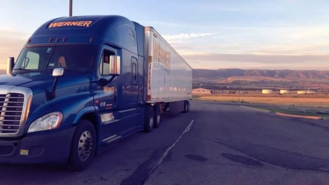 Blue and white semi on road ring sunset. Photo by Instagram user @one_werner