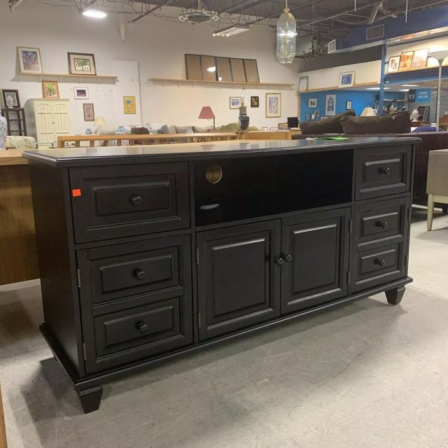 Black cabinet in furniture store. Photo by Instagram user @suffolkrestore